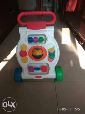Baby's White And Red Fisher Price Musical Walker