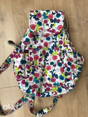 White, Red, Blue And Green Floral Backpack