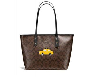 Coach Brown Taxi City Zip Tote at Darveys Delhi