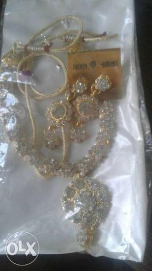 Gold And Diamond Rhinestone Necklace And Pair Of Earrings