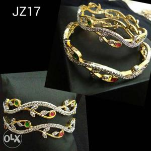 Two Silver And Gold Bangle Bracelets
