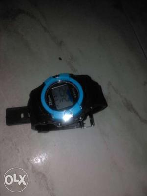 A wrist watch with alarm and stop watch