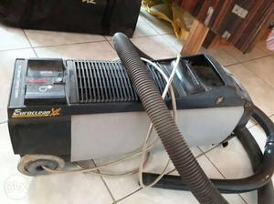 Black And Gray Canister Vacuum Cleaner