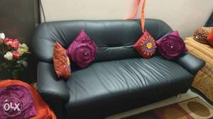 Almost New Branded leatherette 3 seater Sofa.