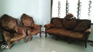 Brown And White Floral Padded Brown Wooden Futon