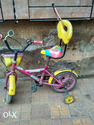 Pink And Yellow Bicycle With Training Wheels