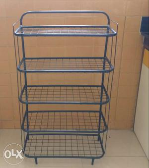 Set of two metal racks with five shelves in excellent