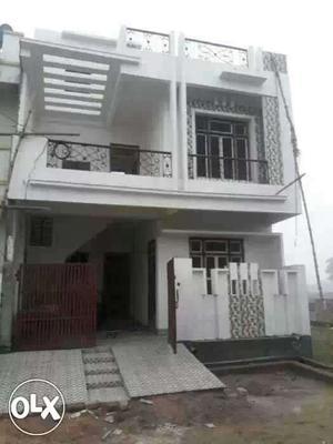 White Concrete Two Storey House