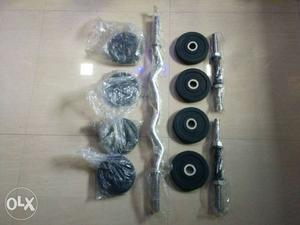 3 Stainless Steel Rods And 8 Black Gym Plates