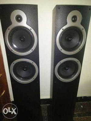 Pair Of Black And Gray Tower Speakers