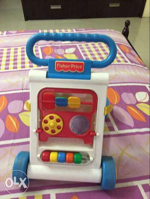 White And Blue Fisher Price activity walker