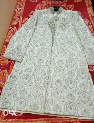 Total set of Men's Manyawar Sherwani of Rs./- Unused.