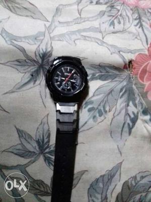 Black Round Faced Chronograph Watch With Silver Link