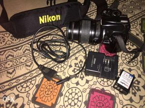 Black Nikon D DSLR Camera With Lens Cap And Charger Set