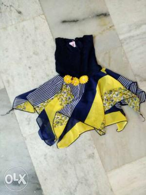 Black, Yellow, And Blue Sleeveless Dress