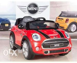 Red Mini Cooper Ride On car rechargeable battery operated