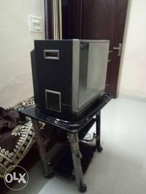 Texla colour tv in good condition with tv trolly