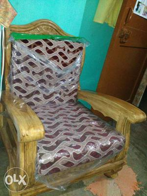 Brown Wooden Cushioned Armchair