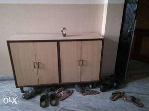 Wooden shoe rack in good condition for sale