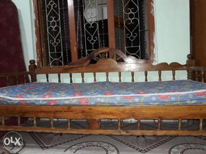 Brown Wooden Daybed With Blue Mattress