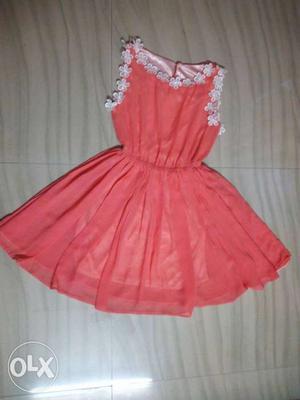 Peach Colour flared dress.