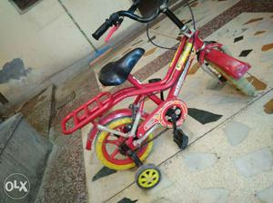 Toddler's Pink And Green Bicycle With Training Wheels