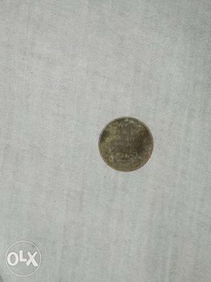 One quarter anna of india .