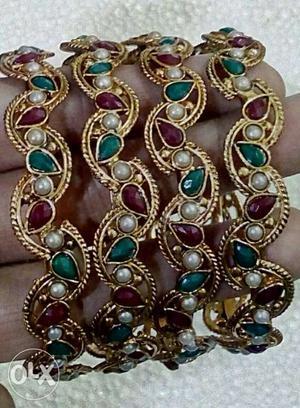 Four Gold Beaded Bracelets