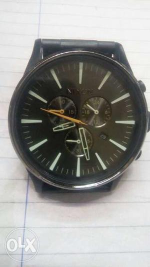 Round Black Bezel Black Face Chronograph Watch With Black
