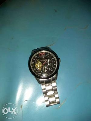 Round Black Mechanical Watch With Silver Link Band