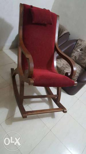 Red Fabric Cushioned Brown Wooden Rocking Chair it is very