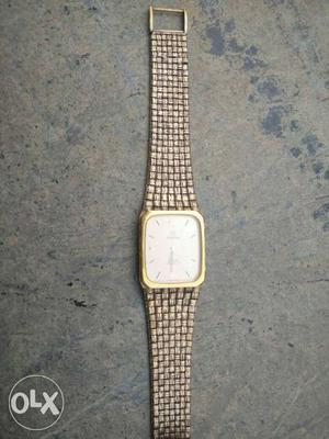 Omega Gold And White Square Faced Analog Watch