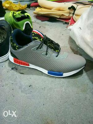 White, Red, And Gray Athletic Shoe