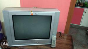Gray CRT TV With Remote Control