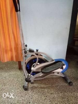 Gray And Blue Elliptical Trainer