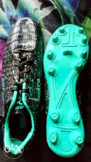 Pair Of Black And Teal Soccer Cleats