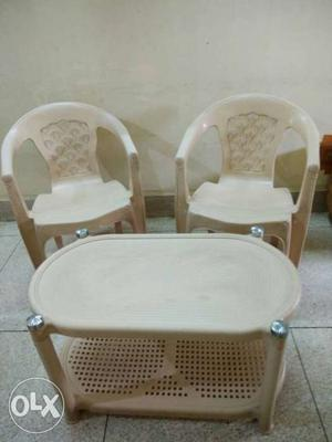 Two White Plastic Armchairs with Centre table
