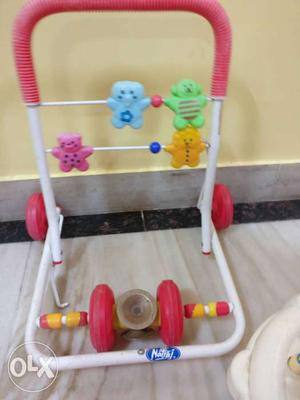Children's White, Pink, Blue And Green Toy