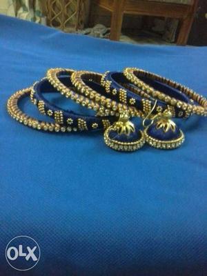 Gold And Black Bangle Bracelets And Juhmkas