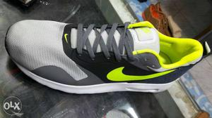 Gray, Black And Green Nike Running Shoe