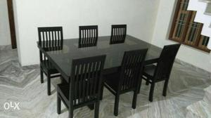 Rectangular Black Wooden Table With Six Windsor Chairs