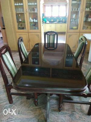 Rectangular Brown Wooden Table With Five Chairs Set
