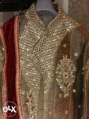 Sherwani with heavy work on front,neck and