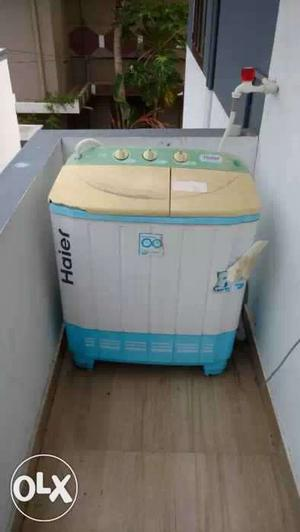 1.5 year old White and Blue Haier semi automatic Washer And