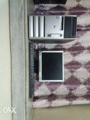 Computer Tower, Flat Screen Computer Monitor And Black