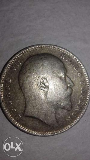 It is a coin of  edward vii king of empire