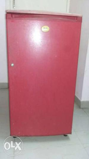 Red color LG fridge in good condition for sale