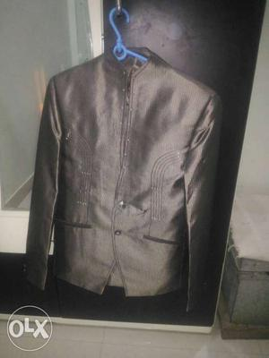 Two piece suit [blazer and pant] in new condition