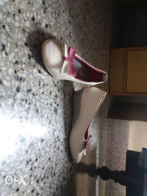 White-and-pink Leather Bow Accent Almond Toe Wedges