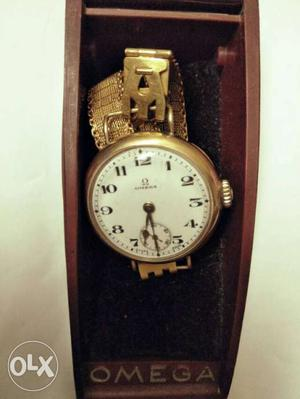 Vintage Omega watch with pure gold bands and dial.